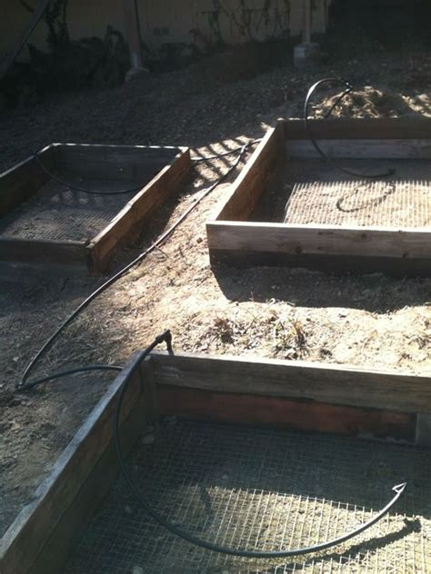 How To Fit Sleepers In Garden by How To Install Raised Garden Beds Prepper Ways