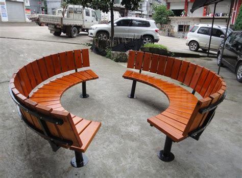 round wooden bench public leisure garden tree soild wood outdoor curved