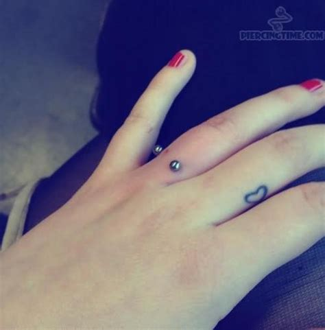 heart tattoo on ring finger tiny heart tattoo and finger ring piercing