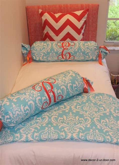 coral and teal bedding custom rolls with large monogram perfect for room mates