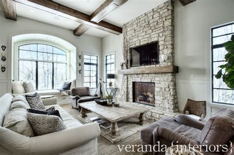 veranda interiors stacked fireplace transitional living room