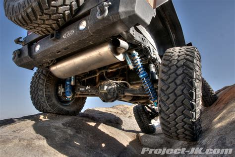Jeep Jk Coilover Rubicat On The Rocks Showing The New Evo Bolt On