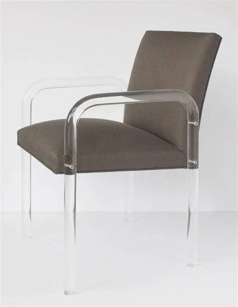 eight modern lucite arm dining chairs set in the style of