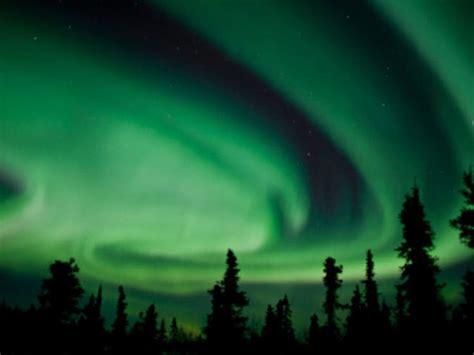 northern lights vacation alaska lighting up the northern lights night sky in fairbanks