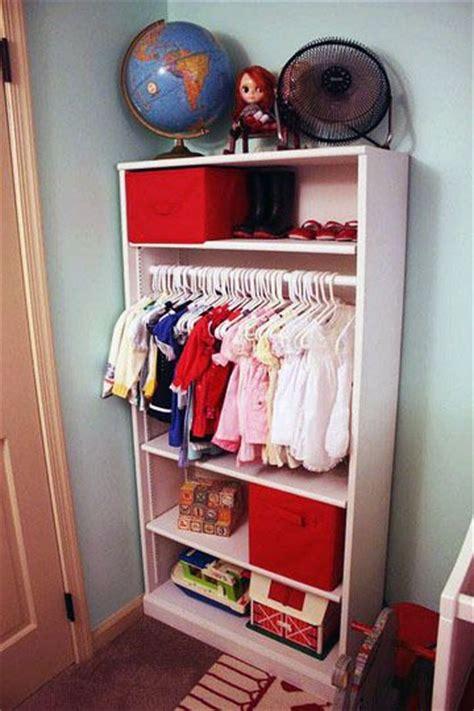 turn bookshelf into closet storage for baby baby