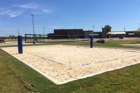 how to build a sand volleyball court in backyard light farms sand volleyball court is complete light farms