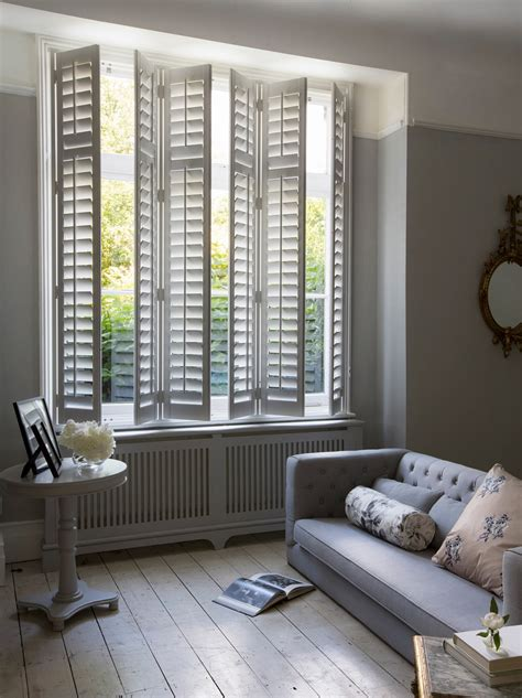 Living Room With White Wood Blinds Sitting Room White Shutters Living Room With White Wood