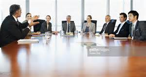 Business Table by Business Meeting At Table In Conference Room Stock