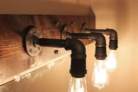 how to install light fixture in bathroom diy industrial bathroom light fixtures