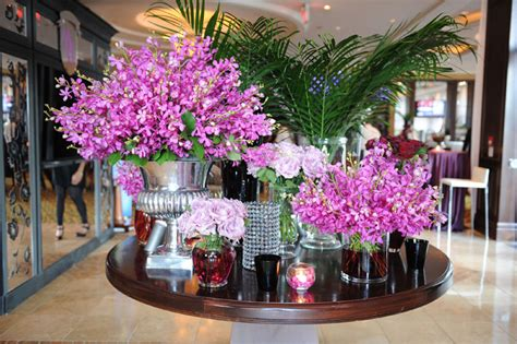 Champagne Dining Room Furniture silver and glass vases of purple flowers inspired by a