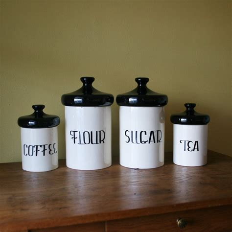 vintage black and white ceramic canister set by
