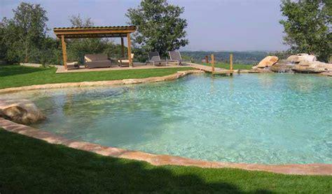 centro benessere giardini immagini piscina effetto spiaggia naturale e in roccia