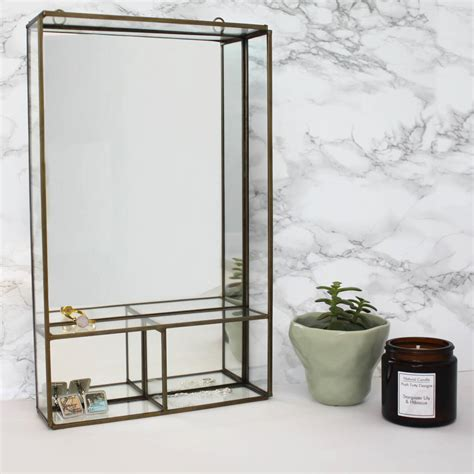 brass mirror with shelves by posh totty designs interiors