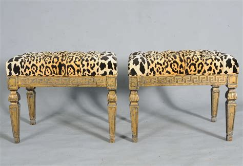 animal print bench pair of gilt benches with greek key apron and leopard