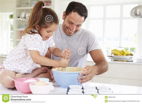 daughters sucking daddy images motherlesscom father and daughter baking cake in kitchen stock photo