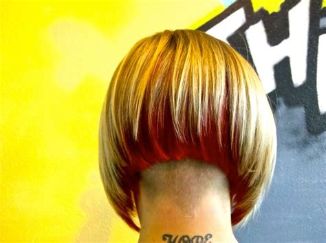underlay hairstyles angled bob with undercut and bright red underlay back