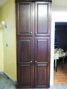 In The Cabinet Free Standing Corner Pantry Cabinet On Brown Laminate Wood