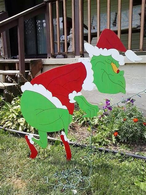 grinch christmas sneaking grinch stealing lights outdoor