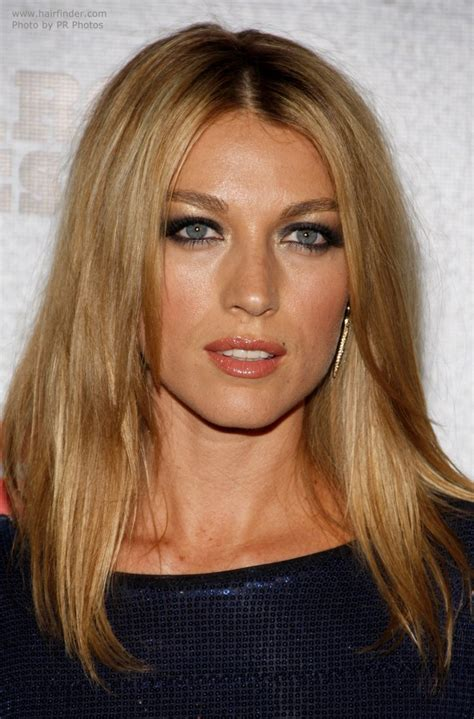 hairstyle for high cheek bone and long face articles and natalie zea with her long hair parted in the middle and