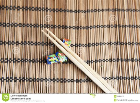 Origami Chopstick Holder - bamboo chopsticks on a handmade origami chopstick holder