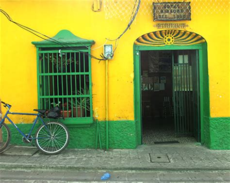 yellow house restaurant travel for kids flores guatemala