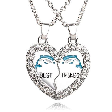 i like how they paired the pendants with a different but best friends dolphin matching heart paired pendant