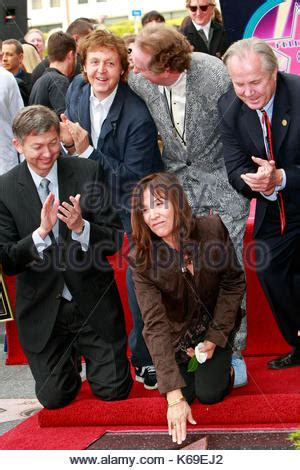 Paul Mccartney Stepping Out With A New Friend by Musicians Tom Petty L R And Paul Mccartney Widow
