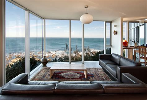 home new zealand architecture design and interiors brown leather sofa glass walls ocean views cliff top