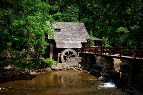 Brown House Near River Trees and Bridge · Free Stock Photo