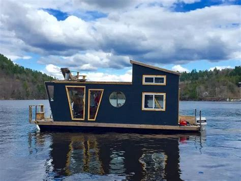 Log Home Interior by Winterproofed Houseboat With A Rooftop Deck Is A Tiny