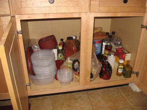 best way to organize kitchen cabinets neiltortorella