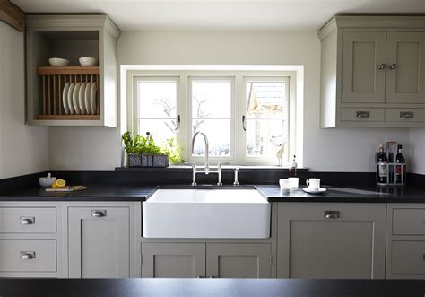 shaker cabinets with honed black granite countery used