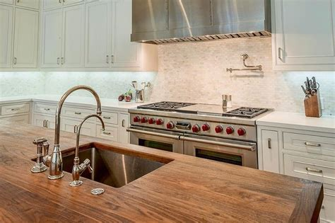 stainless steel kitchen island with butcher block top butcher block island top with stainless steel sink and two faucets transitional kitchen