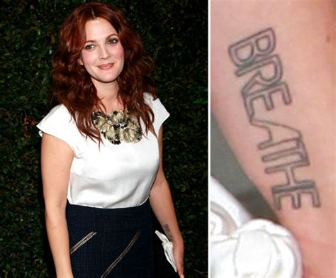 drew barrymore has the word quot breathe quot tattooed on her