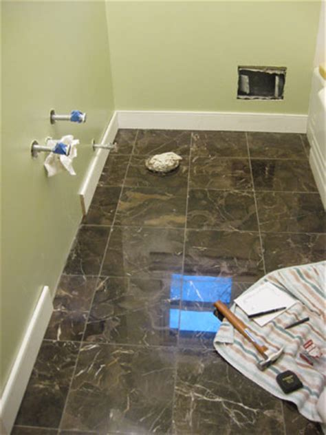 bathroom renovation   install baseboards trim young house love
