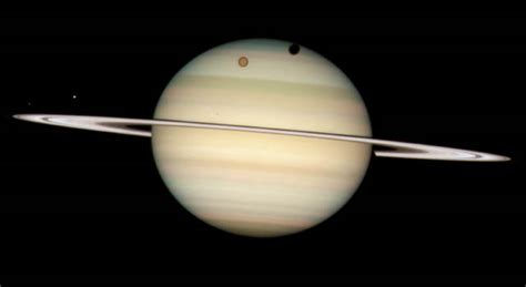 nasa pictures saturn news saturn moon transit snapped by hubble