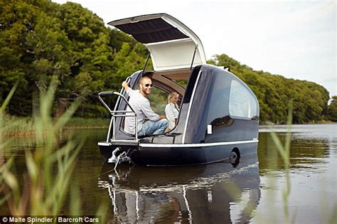 a small motor boat travels 10 mph the world s first floating caravan designed by german