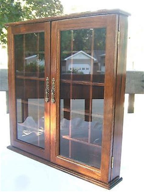 wall hanging wood cabinet with glass door curio display