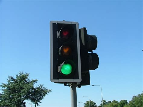 blue lights on traffic signals free photo traffic lights uk sunshine free image on