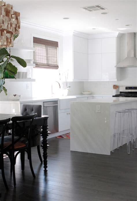 sleek minimal kitchen cabinets no hardware included waterfall kitchen island remodel owens and davis