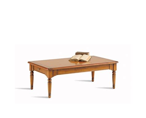 a low table with two drawers made of solid wood selva