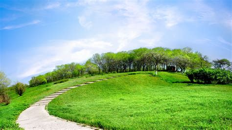 landscaping hills road on a green hill daywallpaper