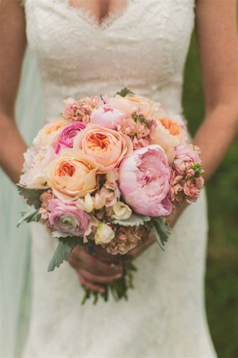 stunning pink peonies greens white roses centerpiece a yellow and peach minnesota farm wedding garden rose