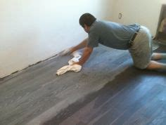 Distressed Flooring Techniques - turn your wood floors gray new floor weathered look
