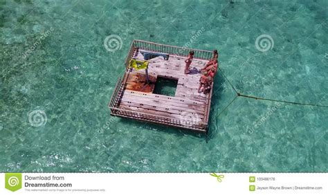 drone with pontoons v09201 group of young beautiful girls sunbathing on