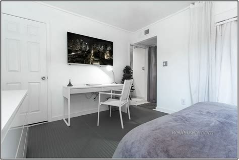 wall to wall bed furniture white wooden desk chair grey carpet connected lcd tv wall exciting designs