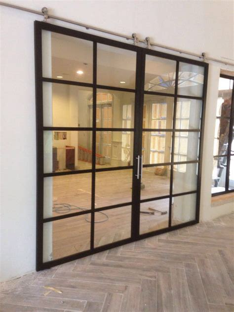 suspended glass barn doors  commercial space project