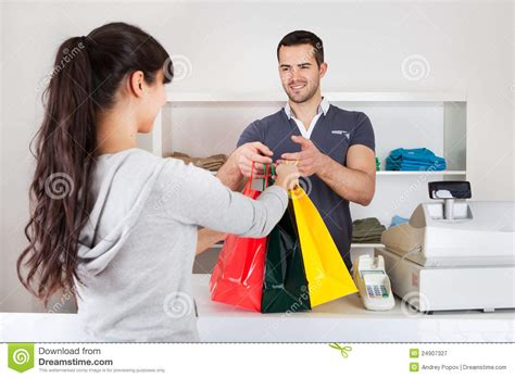 buying a customer buying clothes in shop royalty free stock photography image 24907327
