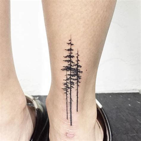 tattoo back of heel pine trees on the right achilles heel tattoo artist