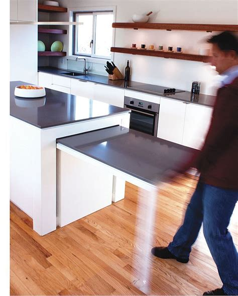 this kitchen island with a pull out table was actually my client s idea he and his wife